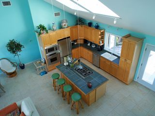 Great Exuma house photo - Looking from the Tranquility room to the kitchen, 65 burner gas stove.