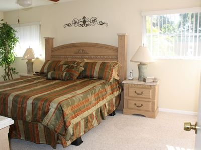 Master Bedroom * King size bed *  pocket sliding door to lanai and pool.
