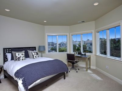 Queen Bed with desk and bathroom
