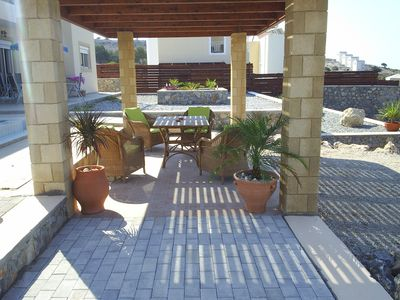 Pefkos villa rental - shaded pergola by pool with BBQ