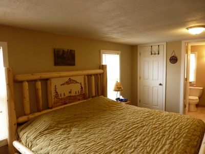 Barryton cottage rental - The master bedroom with a view of the half bath