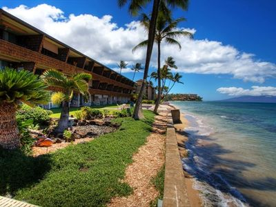 Sea Wall and beach with gorgeous tropical garden within feet of the ocean
