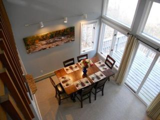 North Conway townhome photo - A view of the dining room and spacious deck from the 2nd floor loft.