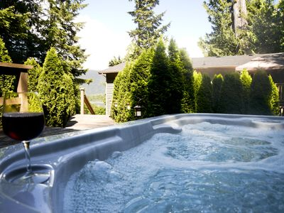 Take a relaxing soak overlooking the inner harbour and mountain views.