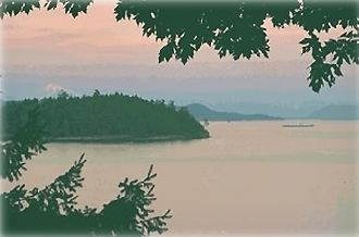Salt Spring Island cottage rental - Mount Baker behind Russell Island with ferry