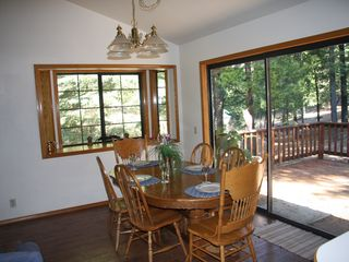 Lake Almanor house photo - Enjoy the view while you have your meals. Table expands to accommodate 8.