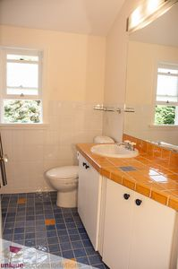 Partial view of four piece Bathroom with heated ceramic floor.