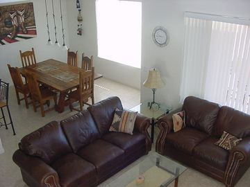 Other Scottsdale Properties townhome rental - View of family room from 18 foot ceiling above(1700 sq foot house).