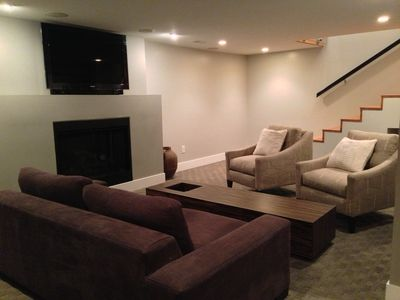Lower level living area w/tv.