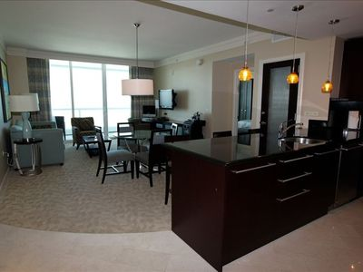 Miami Beach hotel rental - The dining and living areas with full kitchen and a sofa bed.