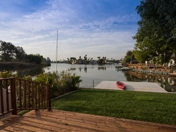 Discovery Bay house rental - This incredible vacation rental home is situated directly on the water.