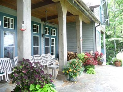 Veranda with rocking chairs and large gas grill