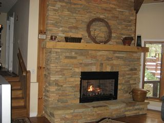 Blue Ridge lodge photo - Warm up or snuggle next to your favorite person or pet by the fireplace.