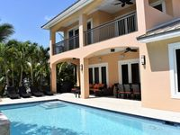 Beautiful new construction house offering 4 bedrooms, pool and on the water!