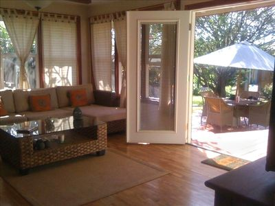 Living Room Couch with Front Door & Deck. Zen Villa Haleiwa.