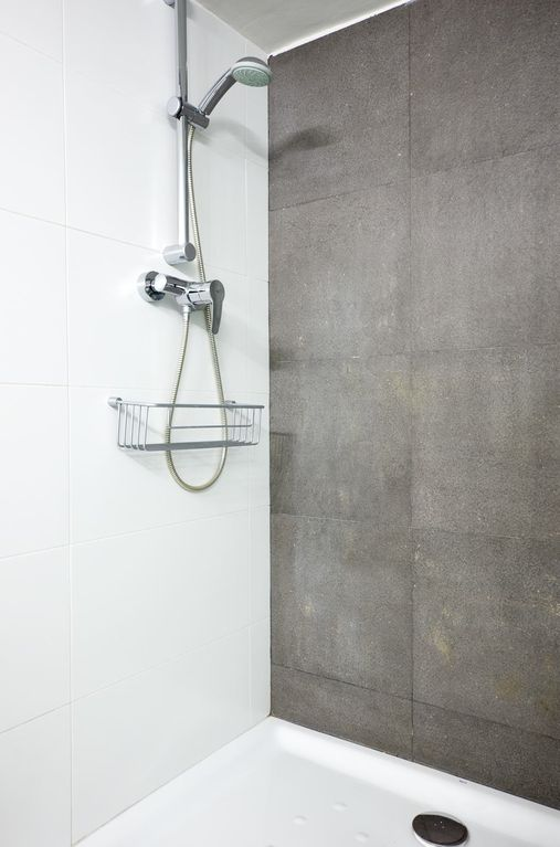 Great, spacious shower with sliding glass door