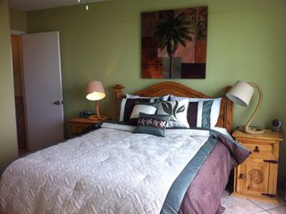 North Padre Island condo photo - Master bedroom with floor to ceiling windows overlooking sand dunes and ocean.