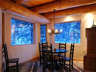 Four O'Clock Breckenridge house photo - Milano Meadows - Breakfast Nook surrounded by snowy trees