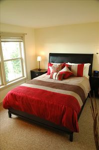 Bedroom with queen bed and luxury bedding