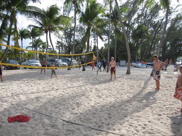 Fun at the Rum Point Club volley ball court right next door.