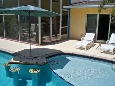 Enjoy lunch at the swim up pool bar and 15' deep sundeck.