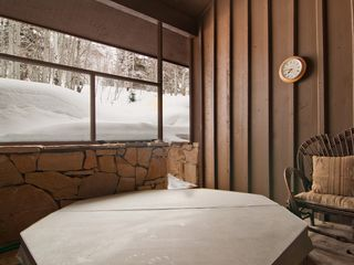 Deer Valley townhome photo - Private hot tub, relax and unwind after a day of skiing, wooded area beyond