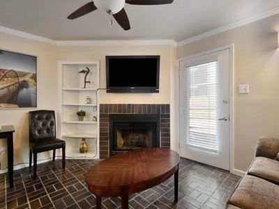 Grand living area - Our one bedroom/one bath condominium in downtown Austin is ideal for groups of four or less.