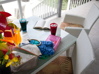 On the lanai there's an easygoing wicker table and comfortable chairs.
