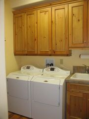 Jackson Hole house photo - Laundry Room off of Kitchen. Maytag Neptune Washer & Dryer + Deep Sink.