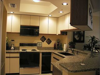 Punta Gorda condo photo - Fully stocked kitchen with granite counters and lunch bar