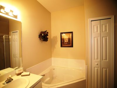 King bedroom ensuite with tub and walk-in shower