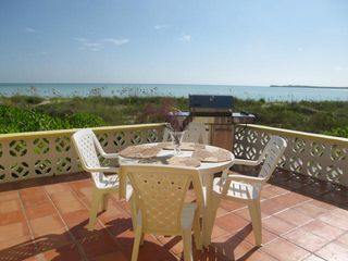 Patio dining with stainless steel barbecue grill overlooking the turquoise sea - Spanish Wells villa vacation rental photo