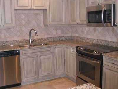 Newly Upgraded KItchen, with Granite Countertops and Tiled Backsplash