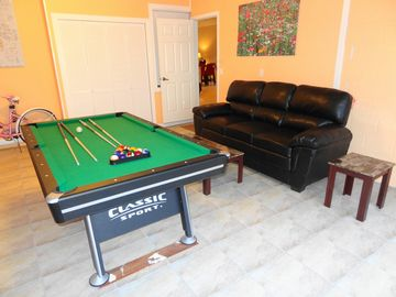 Game room with pool-tennis table