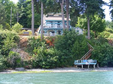 View of home from canoe showing part of the beach and dock.
