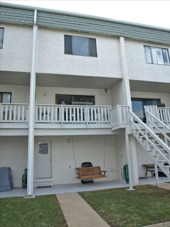 View of back of unit, grill, and porch swing