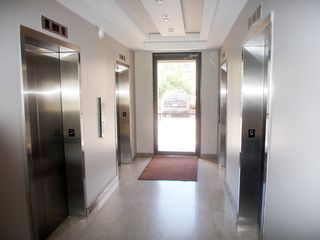 Isla Verde condo photo - Four elevators in building