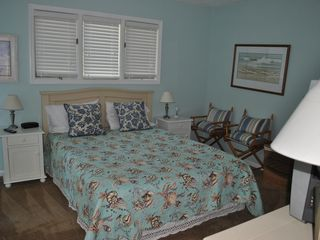 Bald Head Island condo photo - comfortable master bedroom with adjoing bath. Has deck with views of the course