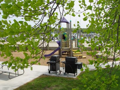Playground and picnic areas with gas grills.