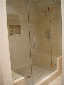 Master Bath Double Showers with Bench and Seamless Glass Door