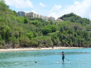Aguadilla condo photo - Paddle Boarding and Snorkeling with 'The Corner Penthouse' in the background