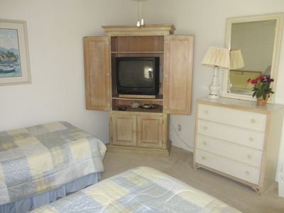 Guest bedroom with two twin beds and TV