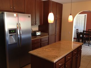 Palm Springs house photo - Kitchen with Island. Kitchen features gas stove and microwave as well