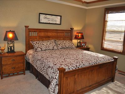 Master Bedroom #1 with king size bed, adjoining master bath and flat screen TV