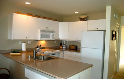 Kitchen with updated appliances, cookware and dishes