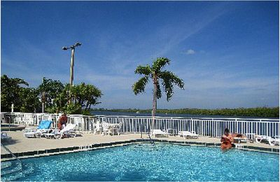 Visit America-Welcome you to our paradise at Bahia Beach. heated waterfront pool