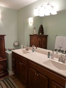 Adult high double sink vanity in master bath
