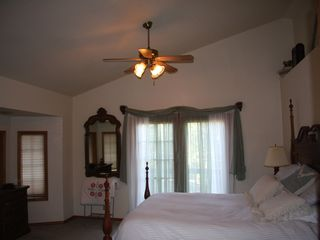 Lake Almanor house photo - Master bedroom has french doors that open to a deck.