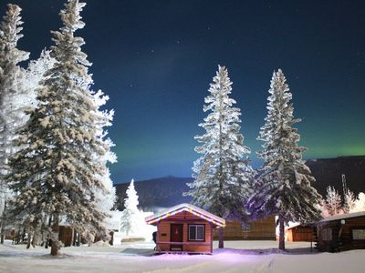 Ferree Cabin in Winter with Aurora Borealis over hillside in background
