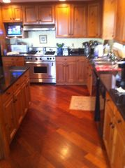 Surfside Nantucket house photo - The well appointed gourmet kitchen with a 4 burner Wolf stove.